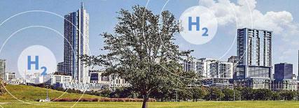Parque con zona verde y ciudad con rascacielos de fondo. En medio aparecen símbolos H2 que indican que es una ciudad que funciona con hidrógeno.